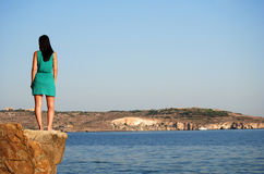 Standing on cliff Royalty Free Stock Photos
