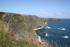 Standing on cliffs, cork county, ireland Stock Photo