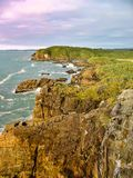 Standing on the rocky cliffs, Charleston, New Zealand royalty free stock photos