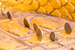 Standing coins in the temple Stock Photos
