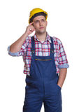 Standing construction worker thinking about the project Stock Photos