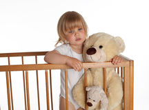 Standing in cot young girl holding Teddybears Stock Photography