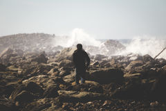 Standing in the crashing waves Stock Photo