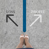 Standing at crossroads. Close up of businesswoman feet standing at line Royalty Free Stock Photos