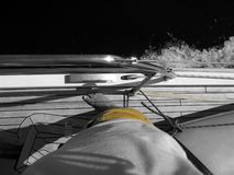 Standing on the deck of a sailboat stock photos
