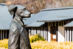 Standing Dog Statue at Ramune Onsen. NAGAYU, OITA, JAPAN - FEBRUARY 12, 2017: This dog statue watches over the distinctive Ramune Onsen bathhouse, designed by royalty free stock photography