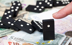 Standing dominoes on bank notes Royalty Free Stock Photos