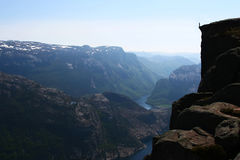 Standing at the Edge - Norwegian Fjord Royalty Free Stock Photo