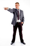 Standing employee pointing sideways Royalty Free Stock Photos