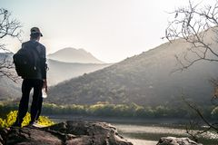 Standing at the end of the High Mountain. Royalty Free Stock Images