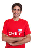 Standing fan from Chile with crossed arms Stock Photos