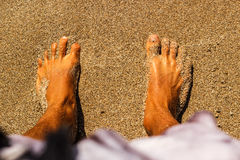 Standing on feet in the sand Royalty Free Stock Photo