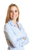 Standing female secretary with blond hair and crossed arms Royalty Free Stock Image