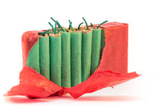 Standing firecrackers in packet. Standing green firecrackers in red packet Royalty Free Stock Photos