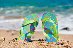 Standing flip flops at the beach Stock Photography