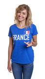 Standing french sports with blond hair and blue jersey Royalty Free Stock Images