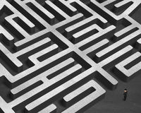 Standing in front of 3D maze. Standing in front of huge 3D concrete maze Stock Images