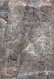 Standing Genie - relief slab from a wall from the palace of King Stock Photography