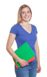 Standing german student in a blue shirt Stock Photos