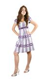 Standing  girl in checked dress Royalty Free Stock Image
