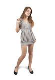 Standing girl in grey dress Royalty Free Stock Image
