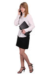 The standing girl with the laptop and phone Royalty Free Stock Photos