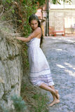 Standing girl near the wall. Girl is waiting near the wall Stock Photography