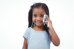 Standing girl on a phone call Royalty Free Stock Photography