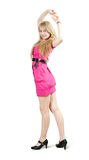 Standing girl in pink dress Royalty Free Stock Photos