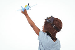 Standing girl playing with toy airplane Royalty Free Stock Photography