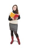 Standing girl reading book Stock Photo