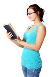 Standing girl reading a book. Royalty Free Stock Images