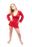 Standing girl in red sexy dress Royalty Free Stock Images