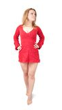 Standing girl in red short dress. Isolated with clipping path Stock Photo