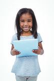 Standing girl using tablet and smiling at the camera Royalty Free Stock Photo