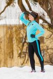 Standing girl, wearing winter sportswear, urban background Stock Photo