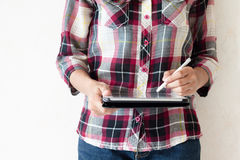 Standing girl writing on a tablet pc Royalty Free Stock Photo