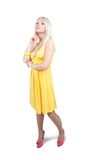 Standing girl in  yellow dress Stock Photo