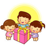 Standing on a great gift for boys and girls. Childrens Character Royalty Free Stock Photography
