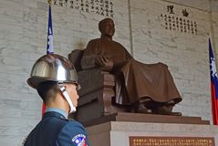 Standing Guard with large statue of Chiang Kai Shek sitting in the background at the Memorial Hall, Zhongzheng District, Taipei stock image