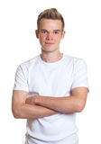 Standing guy with blond hair and crossed arms Stock Photos