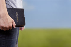 Standing Holding the Bible in a Field Stock Images