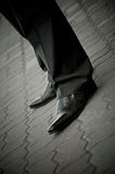 Standing imposing man in a patent leather shoes. legs only. Businessman classical Well-dressed clothing Stock Photography