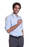 Standing latin guy with beard Stock Photo