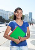 Standing latin student with long dark hair in the city Stock Photos
