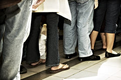 Standing in Line. People standing in line inside a mall stock image