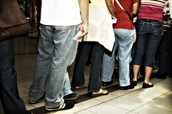 Standing in Line. People standing in line inside a mall royalty free stock photography