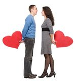 Standing loving holding hearts Royalty Free Stock Image