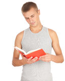 Standing male student reading book. Standing male student in casual shirt reading book, white background Royalty Free Stock Photos