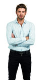 Standing man with arms crossed posing for the camera stock images